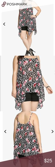 Torrid Floral Chiffon Sharkbite Tank Top SOLD OUT AT TORRID! Floral Chiffon Sharkbite Tank Top. Size 3. Here's a little floral flavor to spice up your day. This flattering tank has a contemporary black and white pattern mixed with lively red and pink roses. It's a lightweight, semi-sheer style complete with a sharkbite hem for a trendy finish. Excellent like new used condition. Worn once on a trip. Could be mistaken as brand new!  (191) torrid Tops Tank Tops