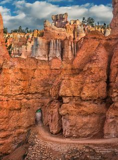 An opening carved through a Hoodoo on the Queens Garden pathway in Bryce Canyon National Park, Utah (by Ron Diel)