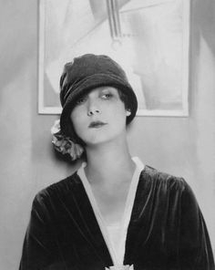 Edward Steichen, Model Wearing Velvet Cloche by Reboux, 1925  ca. 1925 --- Head and shoulders of model wearing an close-fitting, unstructured velvet cloche with a feather flower on one side; designed by Reboux. --- Image by © Condé Nast Archive/CORBIS