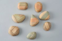 PLYWOOD laboratory | koishi Pebble-like papeweights made by joiig beautiful plywood pieces i a patchwok style.