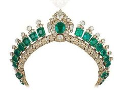 Another diamond and emerald tiara, with a possible attribution to Cartier, though not proved beyond reasonable doubt. Featuring multiple emerald-cut emeralds, rising from a twisted diamond base and topped with three diamonds each, flanking a central diamond motif with a cushion-cut emerald.
