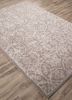 A modern take on Victorian design, this densely patterned, hand-tufted wool and art-silk rug revisits a 19th-century motif. The subdued color palette highlights the intricacies of its ornamental motif.