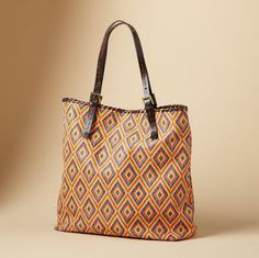 """Sundance - Positano Tote - italian leather shows springtime exuberance— embossed with a basketweave pattern or ikat printed and embossed. Brown leather double handles and whipstitch trim. Fabric lined, with one zip and two open pockets. Made in USA by Carla Mancini. 16""""W x 5""""D x 14""""H."""