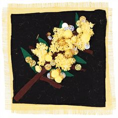Beautiful textile collage of Australian native wattle flowers by the primary school students from Ivanhoe Grammer School, using hessian, felt, pompoms, sequins, wool and other materials. From Zart Art.
