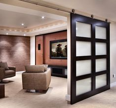 Love this sliding door for the media room!