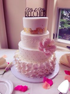 Wedding cake with gold, dots, and ruffles.
