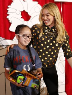 """Hilary Duff and SickKids patient ambassador, Avreen Sahota, launch the Duracell """"Powering Holiday Smiles"""" program, which will donate $1 to Children's Miracle Network for every pack of Duracell Quantum AA-16 batteries purchased by Dec. 27, 2013."""