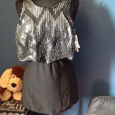 ⬇💕💕Speechless Top💕💕 Black & Silver Top, never worn😘. Ready for the night life😘😘. Button missing from the back Speechless Tops