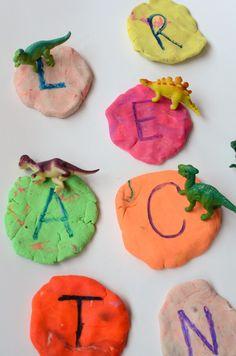Fun pre-writing practice - dinosaur letter stomp! Great fine motor practice for dinosaur loving kids!
