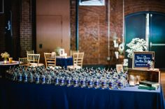Instead of place cards, we had mason jars with names on them and straws with table names