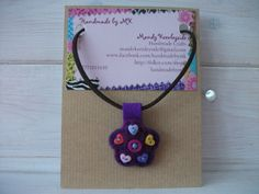 Needle Felted Flower and Button Pendant with a soft cord necklace.  £6.00 plus p&p