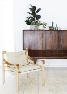 Single Sirocco Chair in oak blending nicely with the deep, rich tones of a rosewood credenza