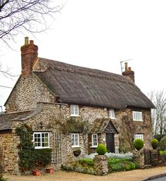 Stone cottage, thatch roof.