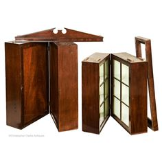 An exceptional, two-part, mahogany campaign Bookcase. The bookcase is made of both solid mahogany and veneer with pine used as the secondary timber. The doors to the deeper base section are panelled with the top section glazed. The interior o Book Cabinet, Cupboard, Stow On The Wold, Campaign Furniture, Cornice, Wooden Bar, Off White Color, Bookcase, Farmhouse