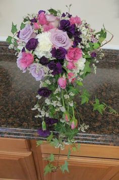 Lovely Lavender, Pink, White, and Purple Wedding Bouquet Made by Perfect Petals Florist and Decor in Cecil County MD. 410-287-0870 or 410-658-1326