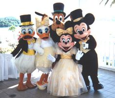A rare look at the formal character costumes that'd be found at Grand Floridian weddings in the late 80s and early 90s.