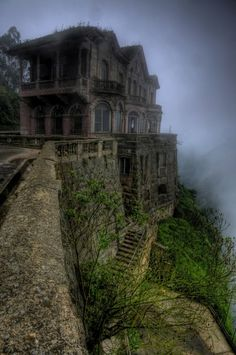 EL HOTEL DE SALTO in Colombia.  The luxurious Hotel del Salto opened in 1928 to welcome wealthy travelers visiting the Tequendama Falls area. Situated just opposite to the 157 meter (550 ft) waterfall and on the edge of the cliff, it provided a breathtaking view to its guests. During the next decades though, Bogotá river was contaminated and tourists gradually lost their interest to the area. The hotel finally closed down in the early 90's and was left abandoned ever since.