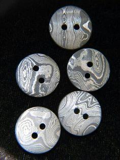 Damascus buttons