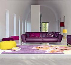 Eggplant/aubergine contemporary leather sofa from Roche Bobois