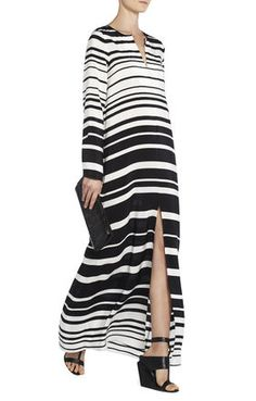 Round neck. Long sleeves. Split at front neckline and skirt hem. Allover striped pattern. Crepe de chine: 100% Silk. Dry Clean. Imported.