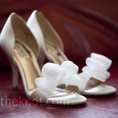 Jodi wore these white-satin open-toe heels for the ceremony and changed into comfy purple wedges for walking on the lawn.