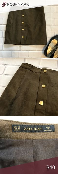 {Zara Basics} Faux Suede Skirt Faux suede skirt from Zara in size XS. Best representation of color is in the close up, it's a beautiful classic brown with an olive tint. The faux suede has a subtle snakeskin pattern. Hardware is brass colored. A few buttons have slight, unnoticeable scratching. Overall excellent used condition. The photo on the model is the same style but the color is slightly lighter. Zara Skirts Mini
