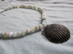 Sea Shell Necklace with Knotted Aquamarine Beads by FruFruDesign, $30.00