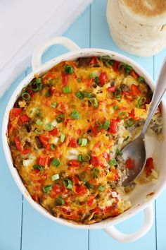 English Muffin Sausage, Egg and Cheese Breakfast Casserole – So delicious and easy! Topped with salty sausage, scrambled eggs and cheddar.