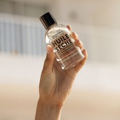 Apply Compagnie de Provence's nourishing Dry Oil to the lengths and ends of your hair to add shine and smoothness. You'll thank us later. Provence, Cocktails, Drinks, Silky Hair, Whiskey Bottle, The Secret, Barware, How To Apply, Oil