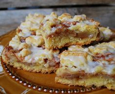 Apple Streusel Bars: Pastry: 2c flour 1/2c sugar ½ tsp bkp ½ tsp salt 1c butter 1 egg/ Filling: 1/2c sugar 1/4c flour 1tsp cin 3 medium sliced + peeled baking apples/ Glaze: 2c powered sugar 3tbsp milk ½ tsp almond ext/ for crust, mix dry ingredients, crumb butter in. Mix in beaten egg. Grease + line 9x13 tin, ph 350. Pat in 2/3 mix. Combine filling, spread on crust, sprinkle on extra 1/3. Cook for approx 40m. Cool, whisk glaze, apply.