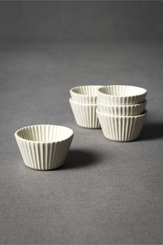 stoneware cupcake liners Say what!? Pampered Chef has a stoneware muffin pan, but I might like these better. ..