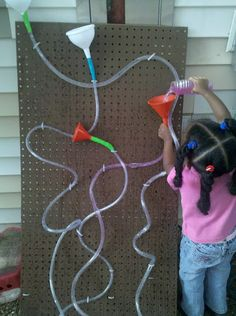 A pegpoard provides students with the opportunity to create their own water runs during playtime outside