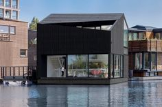 Dutch architecture office i29 has completed a floating home on a canal in Amsterdam that features angled openings and cutaway corners providing views across the watery neighbourhood.