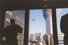 9/11 - local NYC office workers watch the second plane crash into the World Trade Centre twin towers in New York.