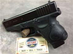 This is an excellent condition, 98-99% condition #Glock model 27 concealed carry #pistol with #Crimson Trace laser grip. The pistol is in immaculate condition. The only visible wear is the tiniest bit of thinning on the top, front area of the barrel where the slide rubbed against it during firing. We believe that this pistol has had maybe two magazines fired through it. If you are looking for a like new condition model 27 with CT #laser grips, but don't want to pay that price, buy this one!
