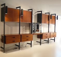 George Nelson CSS Wall Unit for Herman Miller   From a unique collection of antique and modern shelves at https://www.1stdibs.com/furniture/storage-case-pieces/shelves/