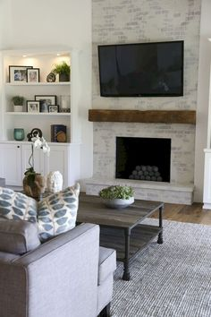 Contemporary living Room Decor - What stores sell decor? Contemporary living Room Decor - When was the first used? Modern Fireplace Decor, Contemporary Fireplace Designs, Brick Fireplace Makeover, Fireplace Shelves, Farmhouse Fireplace, Cozy Fireplace, Fireplace Remodel, Living Room With Fireplace, Fireplace Surrounds