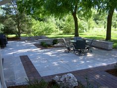 Brick and limestone patio with accent walls and fire pit.
