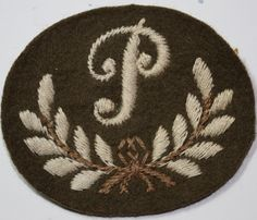 This is an original British cloth arm badge of WW2, being the 'P' in wreath badge for Royal Artillery Plotter. Dont be fooled by modern copies that abound on the internet. These are the real deal.   eBay! British Army, World War Ii, Badges, Ww2, Arms, Germany, Internet, Holiday Decor, Modern