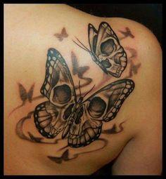 Skull butterflies tattoo
