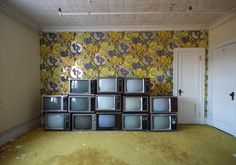 TVs stacked up in a room of the abandoned Adler Hotel.