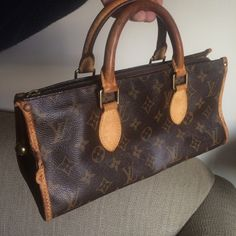 Authentic Louis Vuitton popincourt Authentic Louis v popincourt carry handle tote monogrammed canvas leather nice patina to handles zipper closure goldtone decor w/Louis star flower leather zipper pull outter edge leather has a small tear upper leather outter edge at stud a slight small separation local leather repair can fix inner is immaculate date code tag on inner side pocket VI 1005 no stains on inner has slight Louis leather odor is older & pre-owned  no stains on outter leather canvas…