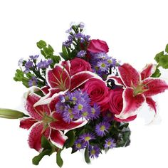 FiftyFlowers.com - Flower Table Arrangment Pink Purple Perfection. 15 for $235, unsure if put together and from Ecuadorian farm