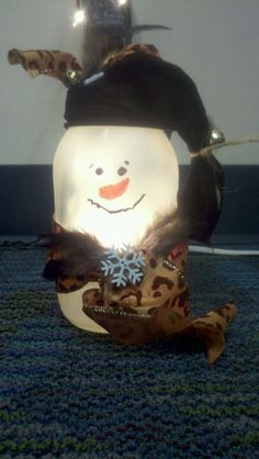 Snowman mason jar!! He lights up! So cute: :-) Hand crafted by Christy Kirkwood