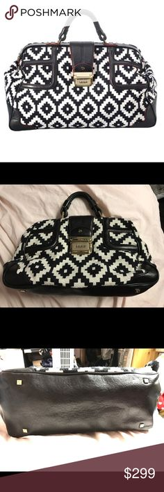 """LAMB Gwen Stefani Black and white Tweed Bag Have here a SUPER RARE bag from LAMB. This was purchased at their Sample Sale a few years ago. Black Leather trim with tweed on body. I used this once/twice. Bag looks almost new!! Please see pics As always Authentic 100 %, Retails $495.                 Width 17.0"""" Height 10.0"""" Depth 7.25"""" Handle Drop 3.5"""" L.A.M.B. Bags Satchels"""