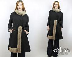 Vintage 60s Black Princess Fur Coat M L Fur Coat Black Coat Belted Coat Fitted Coat 60s Coat 1960s Coat Space Age Coat by shopEBV on Etsy https://www.etsy.com/listing/269210165/vintage-60s-black-princess-fur-coat-m-l