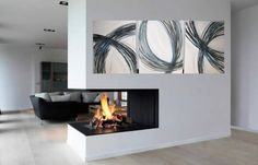 Modern art $120 for set   Love the art & the cool fire place