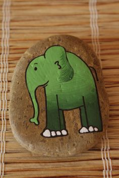 Pebble art...a green elephant ...maybe he should be pink!