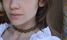 This leather floral choker is actually still cute. No doubt Urban Outfitters is all over this. | 34 Pieces Of Super '90s Jewelry