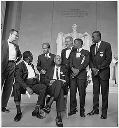 Leaders if the 1963 Civil Rights March on DC. (L-R ) Mathew Ahmann; (beside) A. Philip Randolph: (standing behind) Rabbi Joachim Prinz ; (w/bow tie) Joseph Rauh, John Lewis & Floyd McKissick. Photo created by: U.S. Information Agency, Press and Publications Service